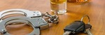 shot-glass-with-car-keys-and-handcuffs